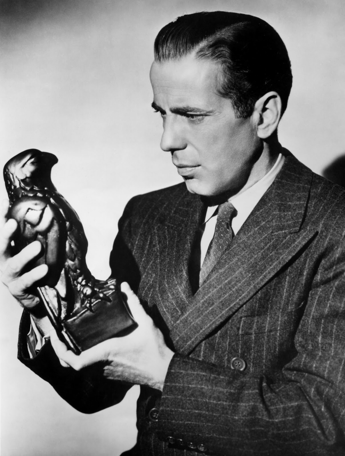analysis of sam spade The maltese falcon analysis imagery, allegory setting the maltese falcon is set in the foggy but when she walks into the office of detective sam spade.